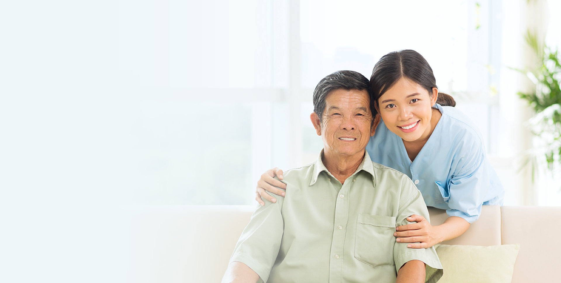 caregiver and senior patient smiling