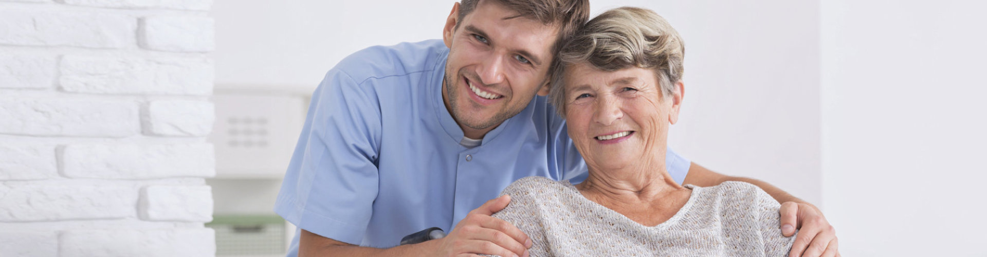 caregiver hugging senior woman with dementia