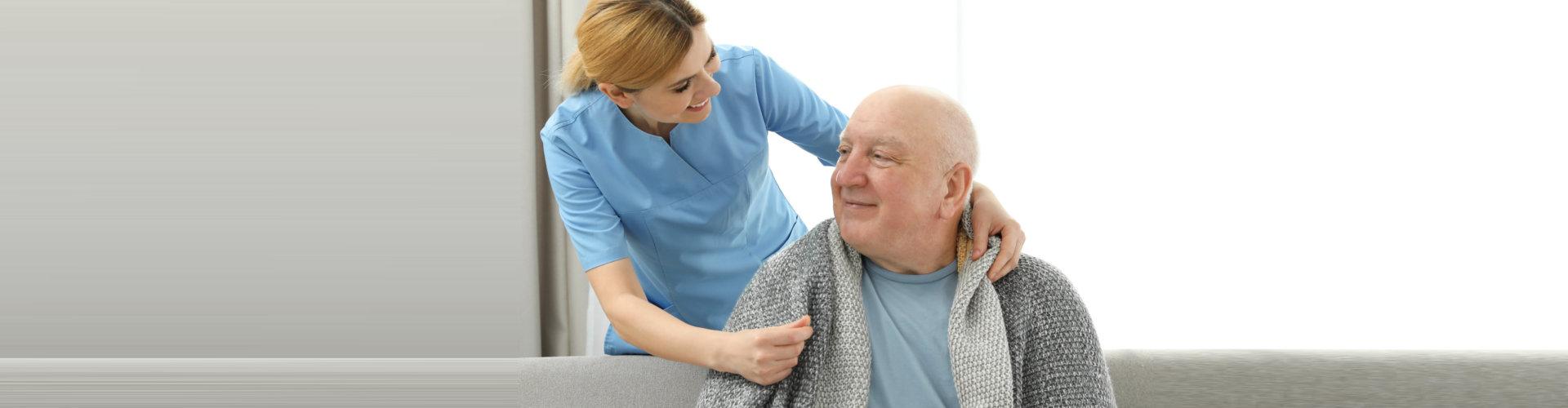 caregiver keeping her patient warm